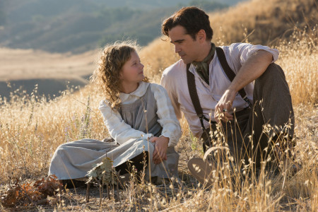 A flashback featuring a young P.L. Travers (Annie Rose Buckley) and her father (Colin Farrell) in Saving Mr. Banks (2013)