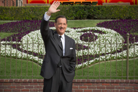 Walt Disney (Tom Hanks) waves to onlookers at Disneyland in Saving Mr Banks (2013)