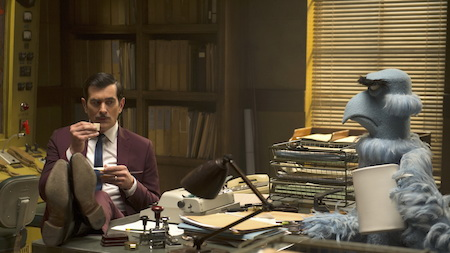 Interpol inspector Jean Pierre (Ty Burrell) and CIA detective Sam the Eagle in Muppets Most Wanted (2014)