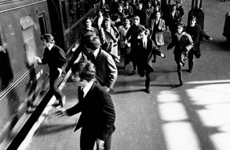 The Beatles are chased by a mob screaming fans in A Hard Day's Night (1964)