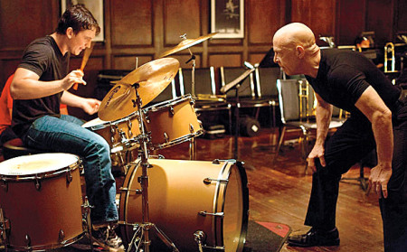 Fletcher (J.K. Simmons) pushes aspiring jazz drummer Andrew (Miles Teller) past the limit in Whiplash
