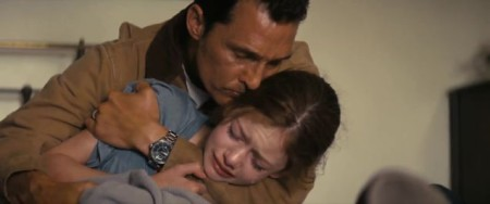 Cooper (Mathew McConaughey) comforts his daughter in Interstellar
